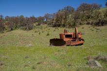 Rusty bulldozer in a field